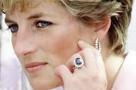 princess dianas engagement ring the background - Princess Diana Wedding Ring