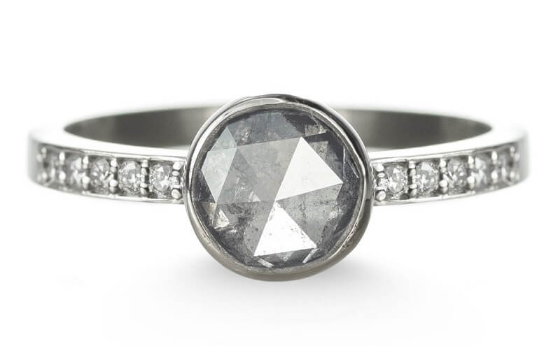 rose shaped diamond ring with smaller diamonds on the side
