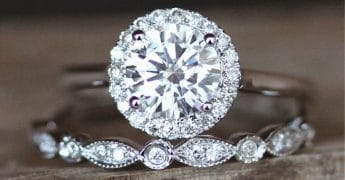 two moissanite engagement and wedding rings