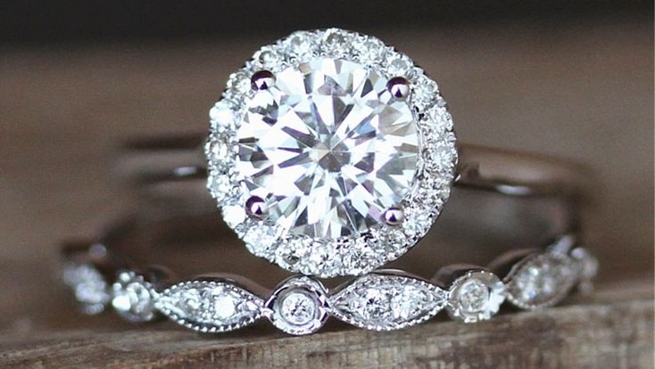 two moissanite engagement and wedding rings. moissanite is a better choice in the moissanite vs cubic zirconia comparison.